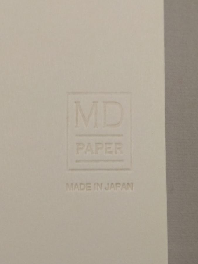 Embossed Midori MD logo