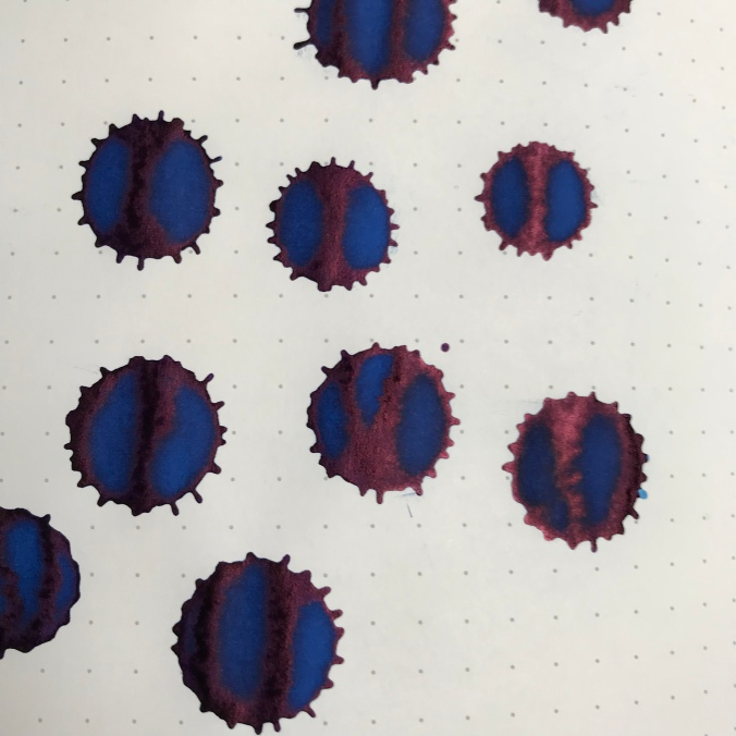 Ink splats showing sheen